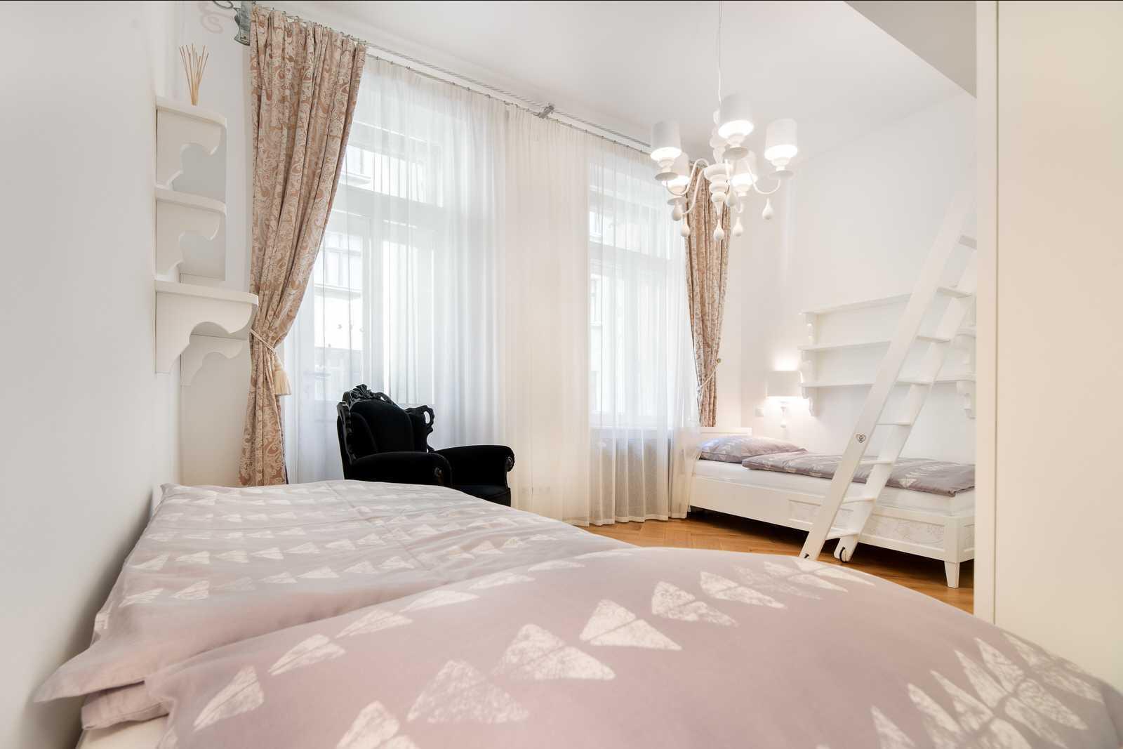 Ljubljana 2-bedroom Beethovnova apartment's twin bedroom with a gallery and a balcony