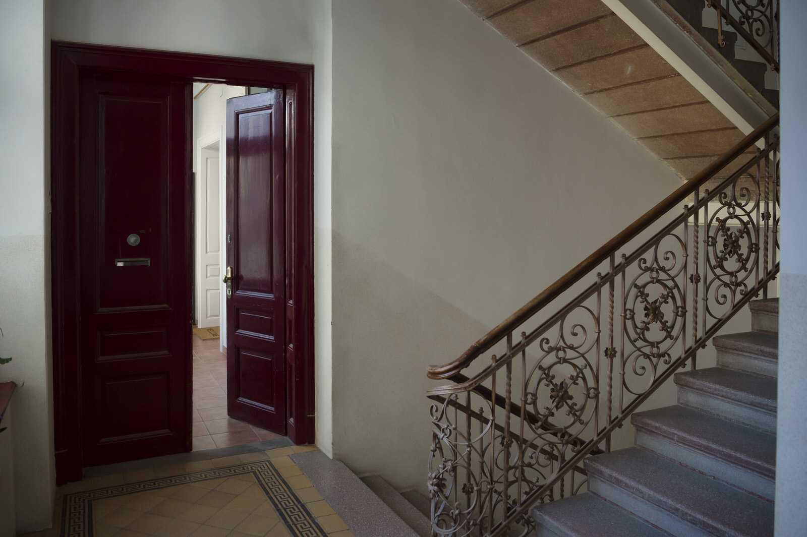 Ljubljana rental apartment features double-wide, dark red doors