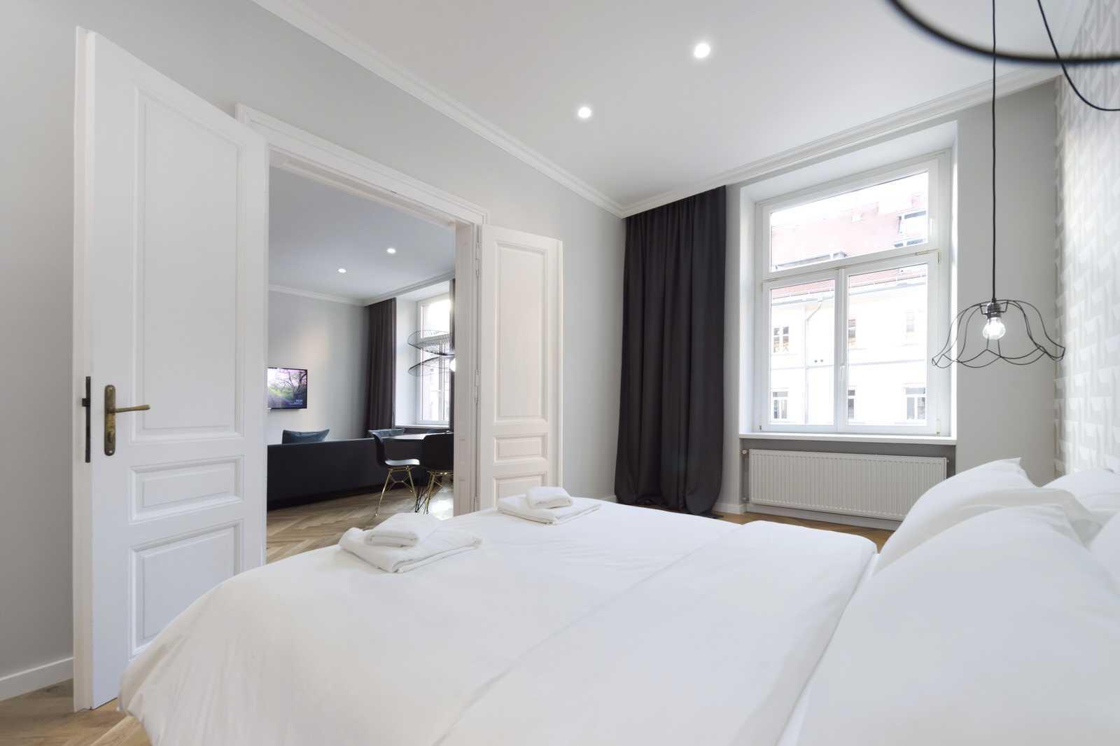Master bedroom with queen bed in Ljubljana rental apartment