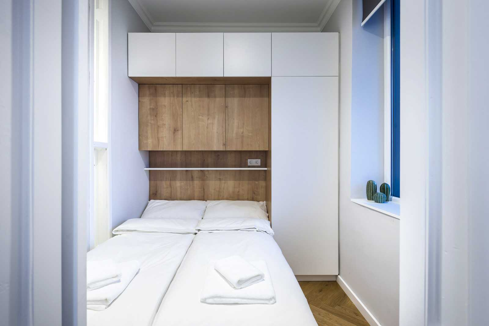 Small bedroom with queen-sized bed in Ljubljana rental apartment