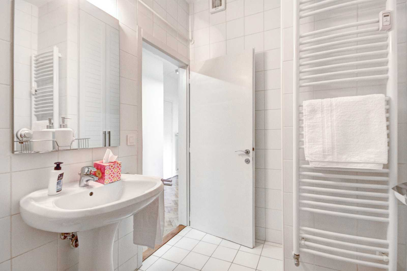 Main bathroom with bathtube in the 2-bedroom rental apartment Slovenska street.