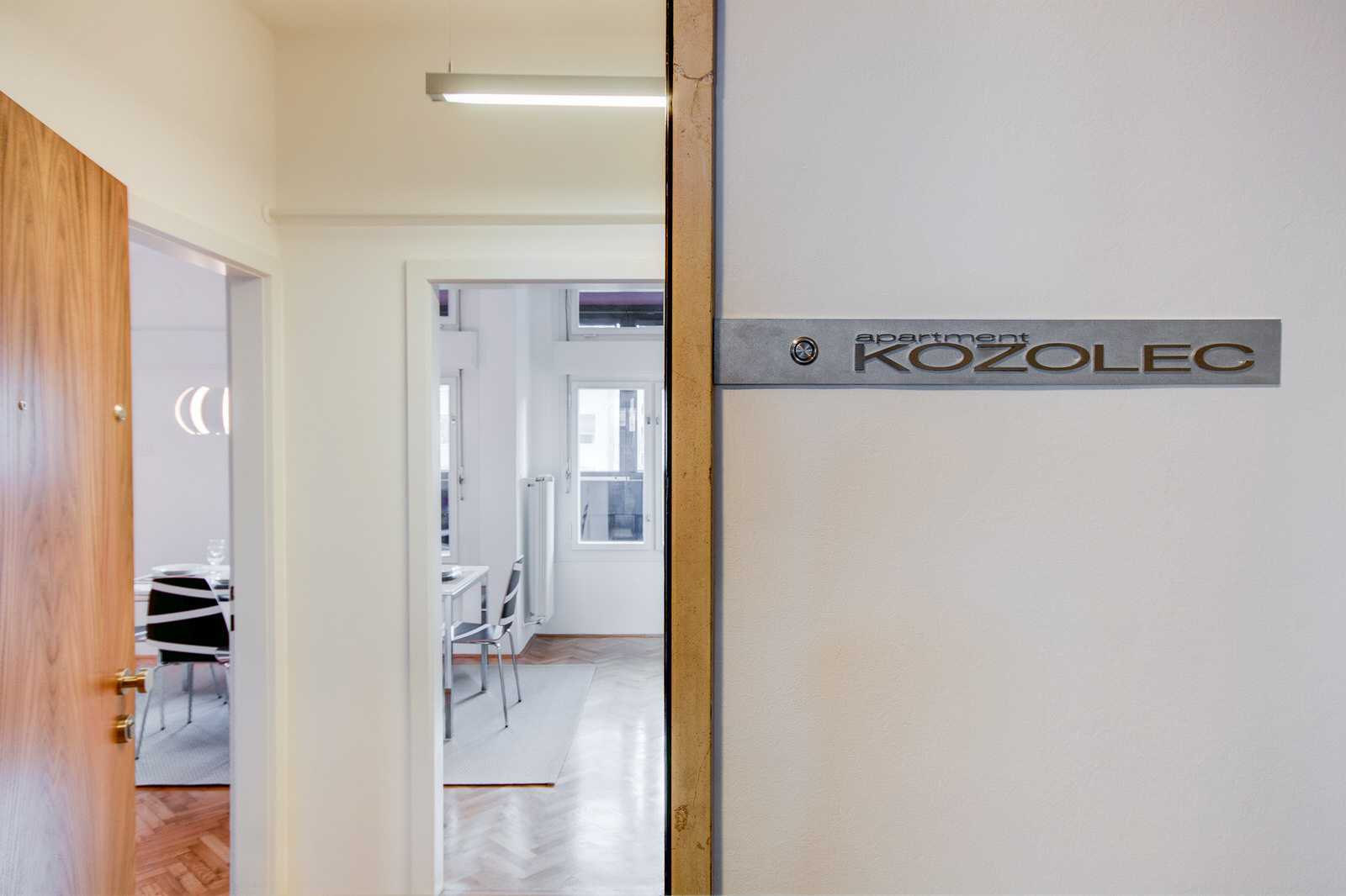 This 2-bedroom apartment rental is located on the second floor of a building with a lift, behind the door with Kozolec plate.