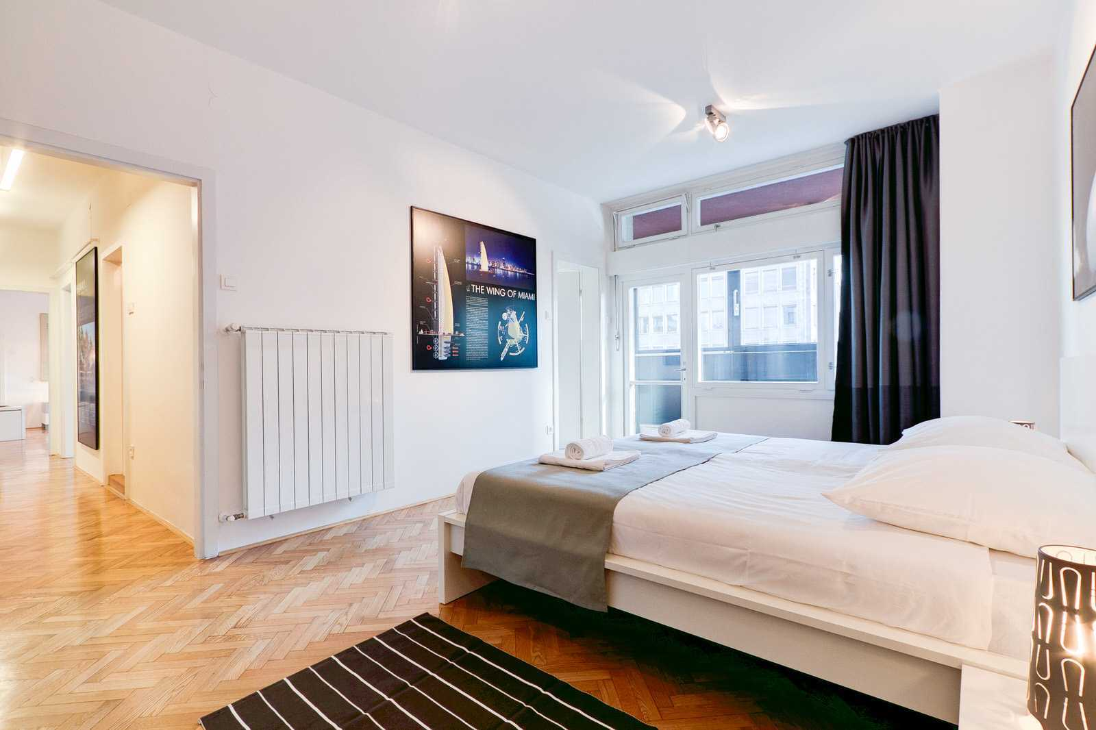 Master bedroom has a king size bed and en suit bathroom with a shower plus a balcony exit.