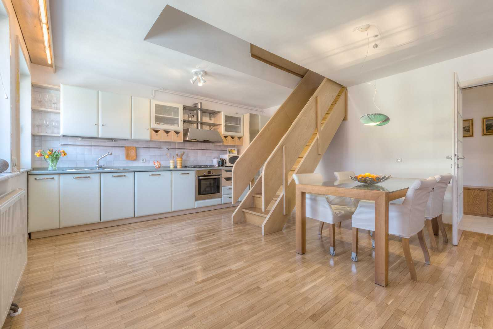 Ljubljana rental apartment Dalmatinova - kitchen and dining area that can comfortable sit six adults.