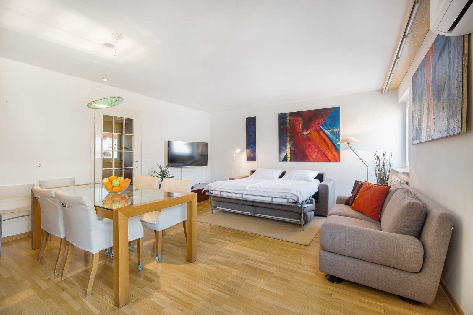 Ljubljana rental apartment Dalmatinova - streched sofa bed with a real mattress for comfortable sleep.