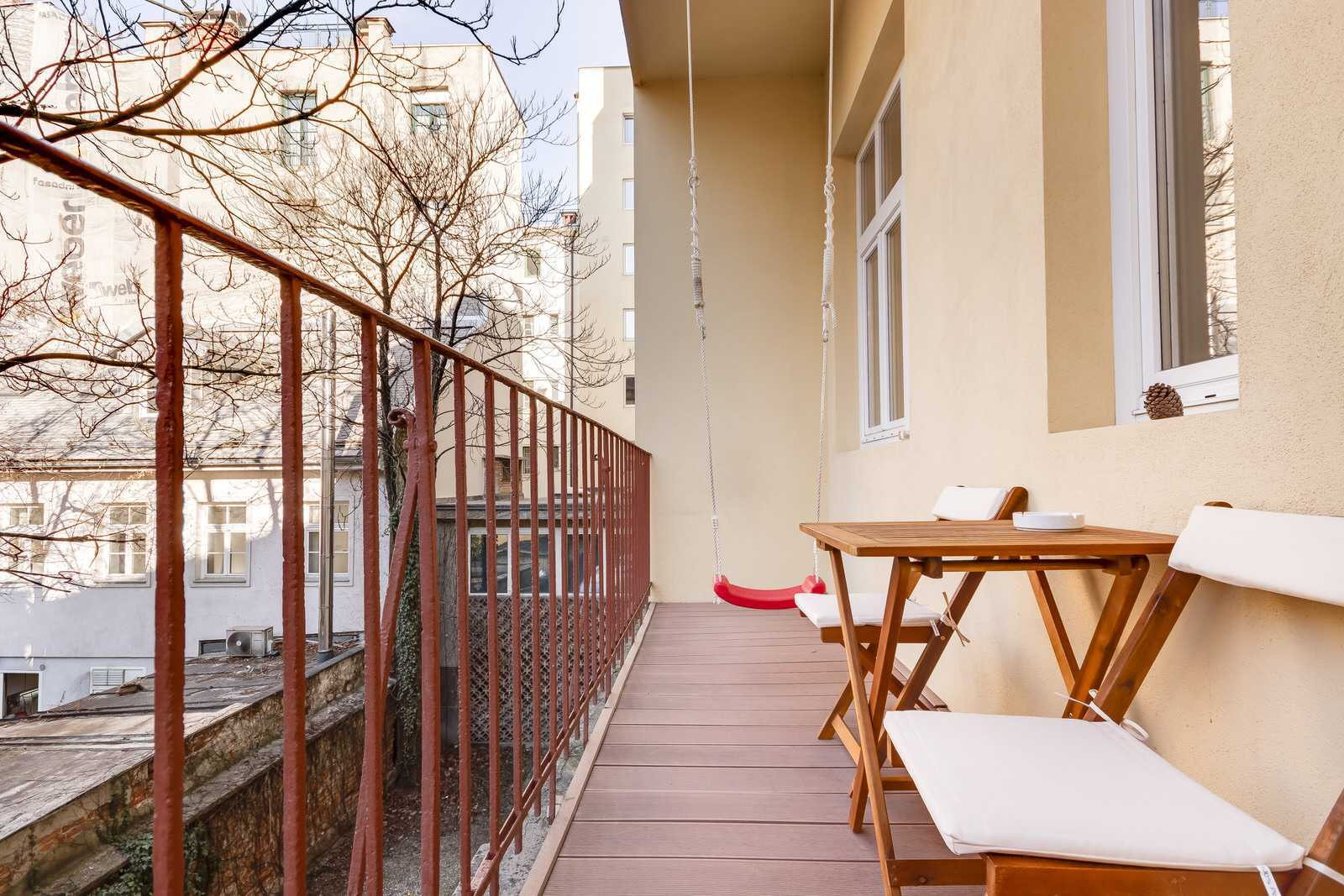 Cozy balcony with a children swing overlooking the inner yard.