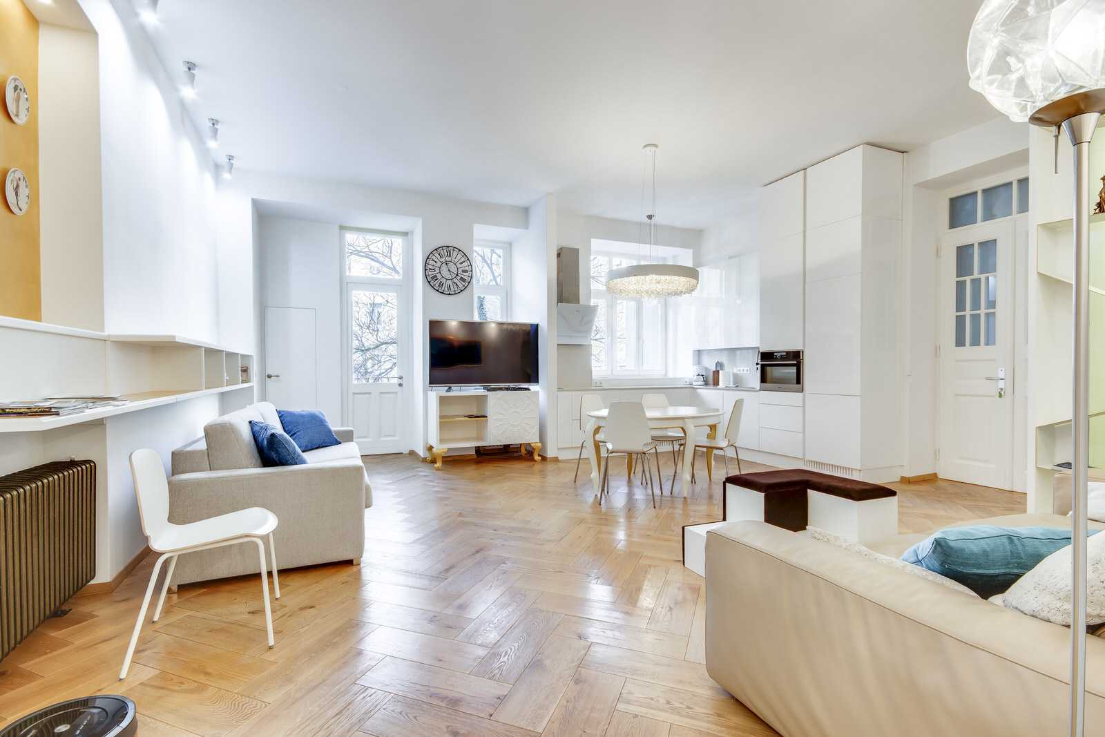 Modern, bright and extremly cozy open space living area with high ceilings, big windows and restored parquet floor.