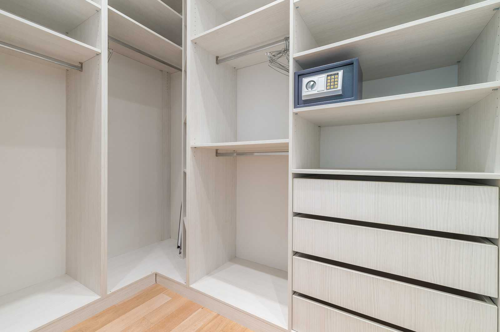 You can walk into a large walk in closet through the bedroom.