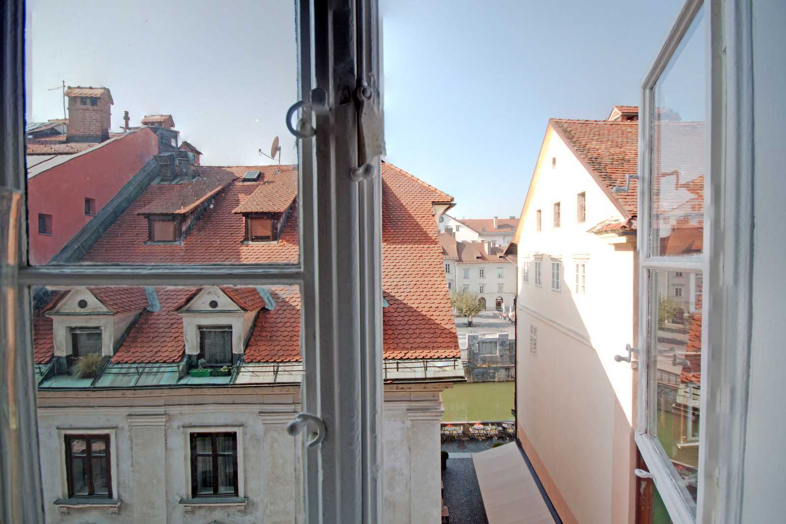 The apartment has great views of the Ljubljanica river and Ljubljana rooftops.