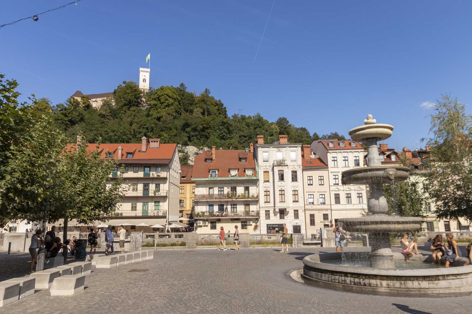 This is the view of the fountain and the Ljubljana Castle hill from across the river.