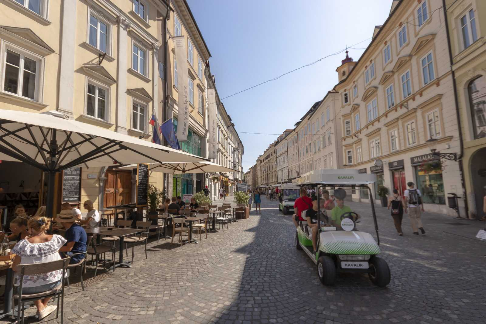 The electric car takes guests around the old town for free.