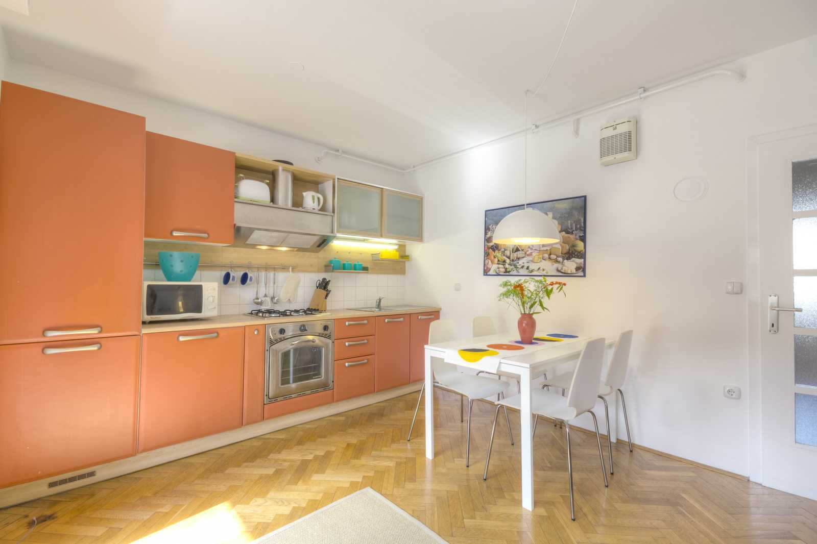 Parquet flooring acroos the apartment makes it feel warm. Fully equipped kitchen is a pleasure to cook in.