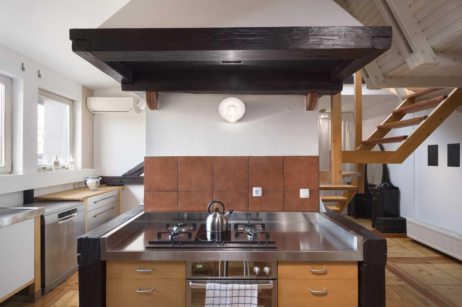 The cooker has six burners.