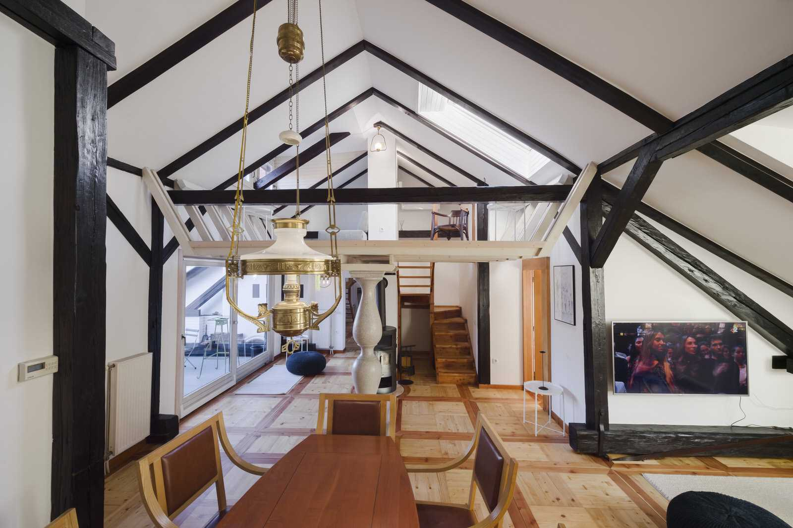 The exposed wood beams add a cozy touch.