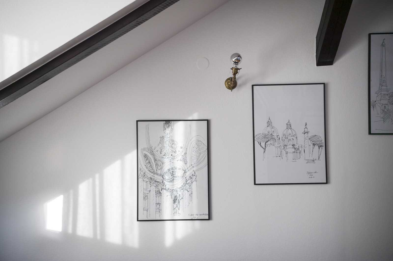 The walls are decorated with sketches of European capitals.