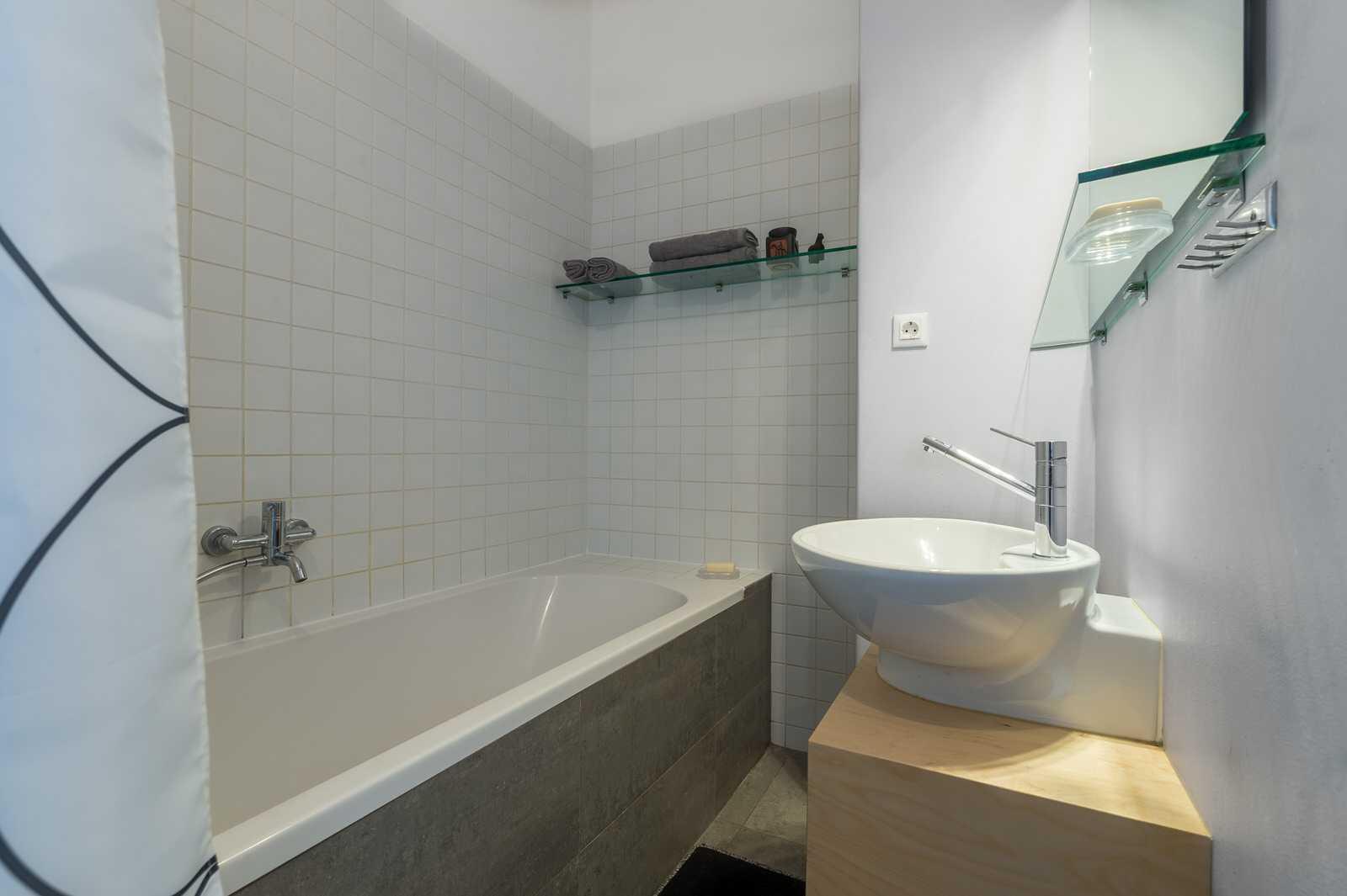Take a bath in this modern bathroom.