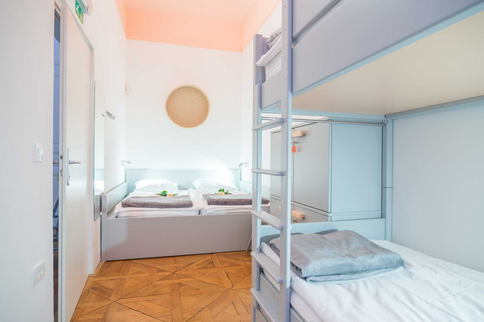 This bedroom has one double bed and one bunk bed.