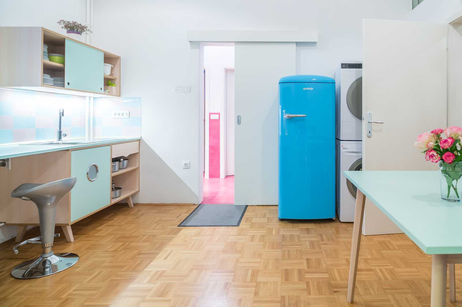 The kitchen features bright retro appliances.