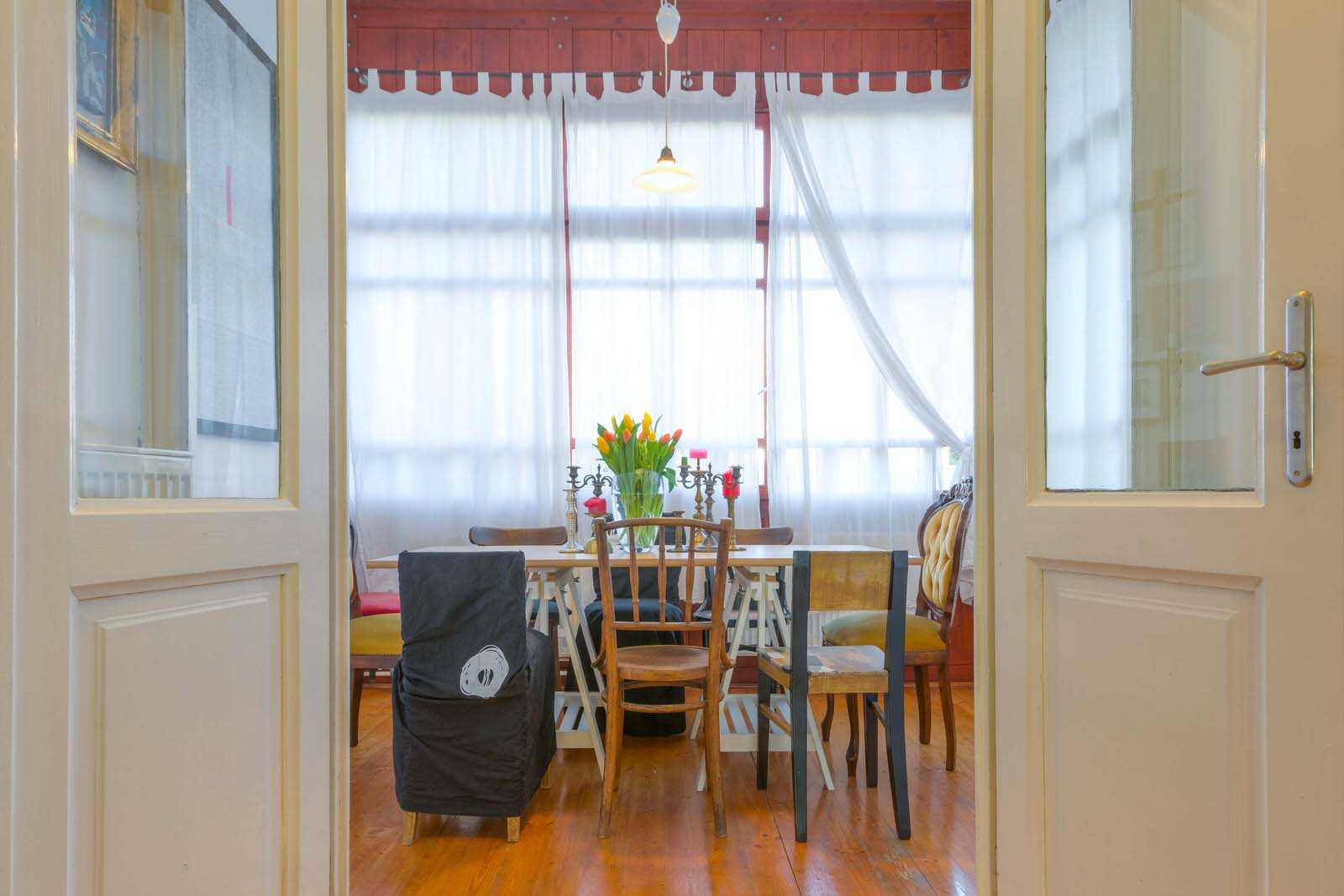 The dining room has tall windows providing the apartment with great daylight.