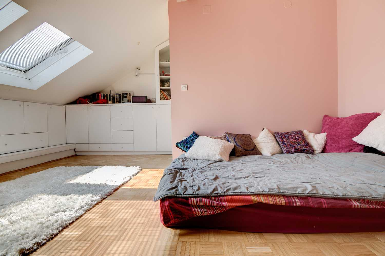 The bedroom has plenty of storage space.
