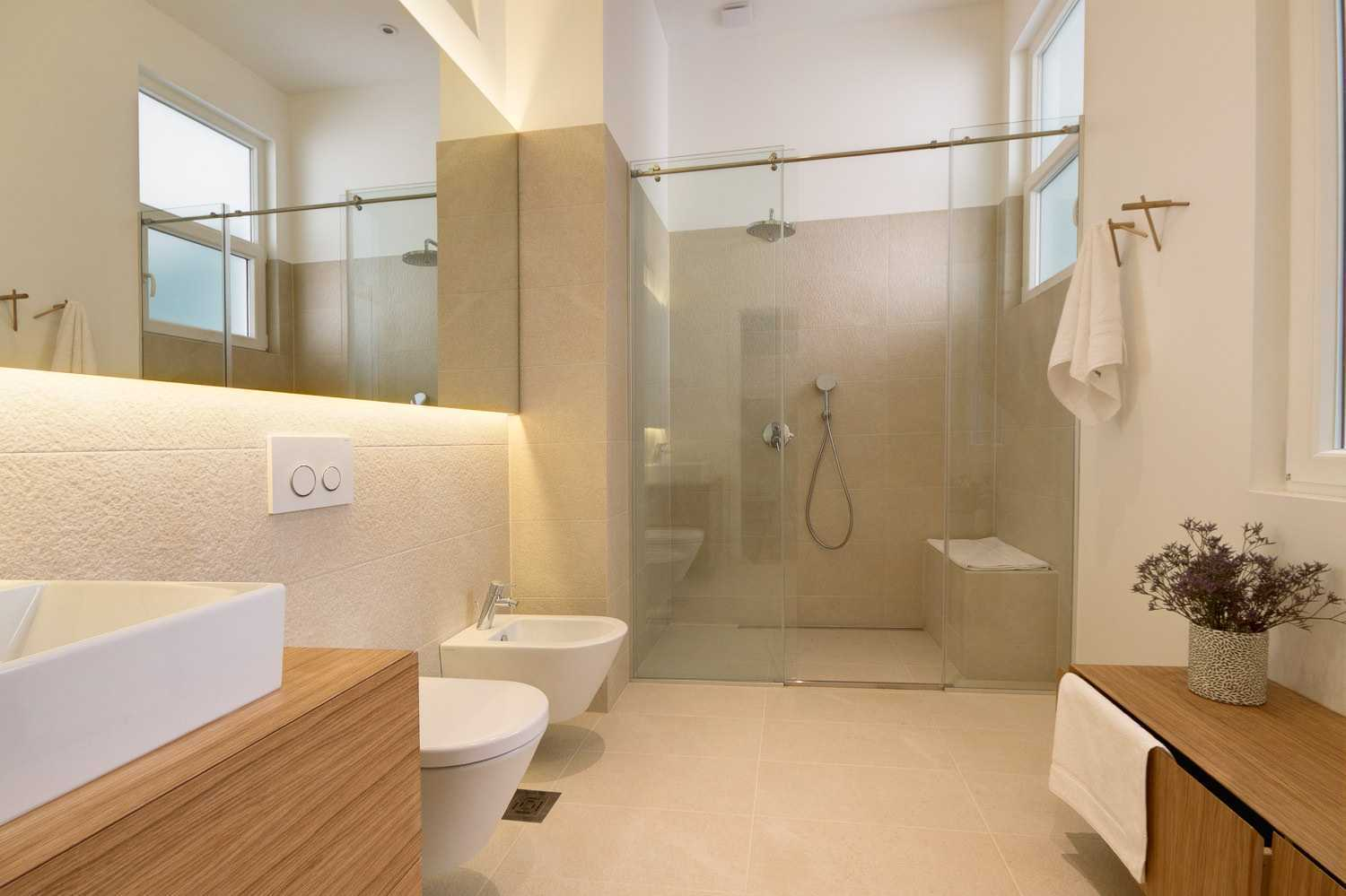 One of the bathrooms has a spacious walk-in shower.