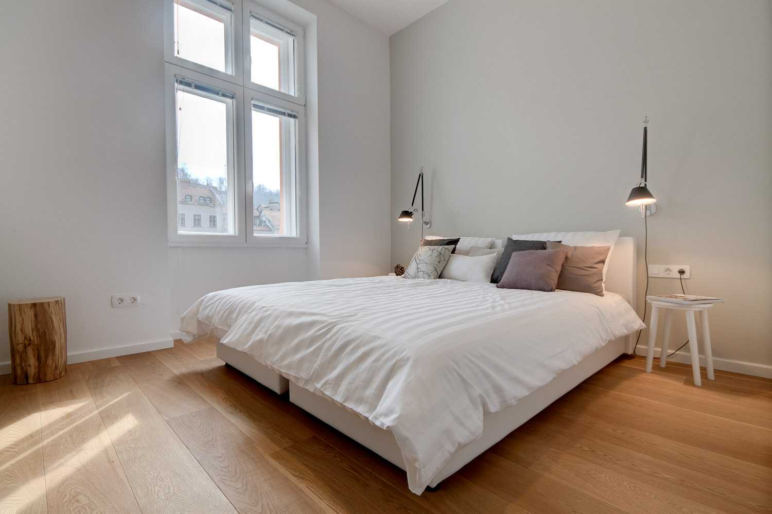 The apartment is designed in light wood and white walls.