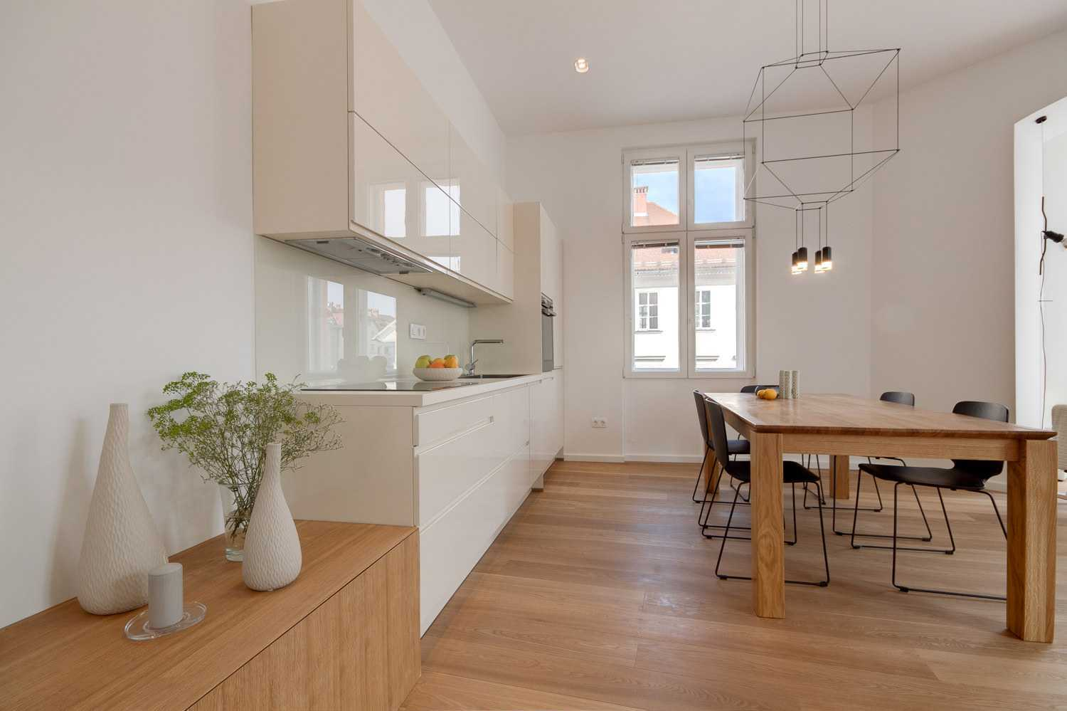 The kitchen is sleek and fully equipped.