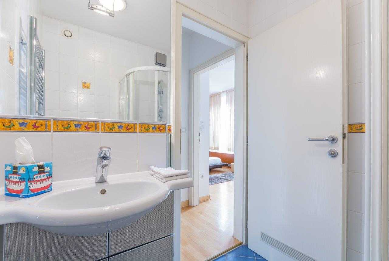 The second bathroom is bright and colorful.