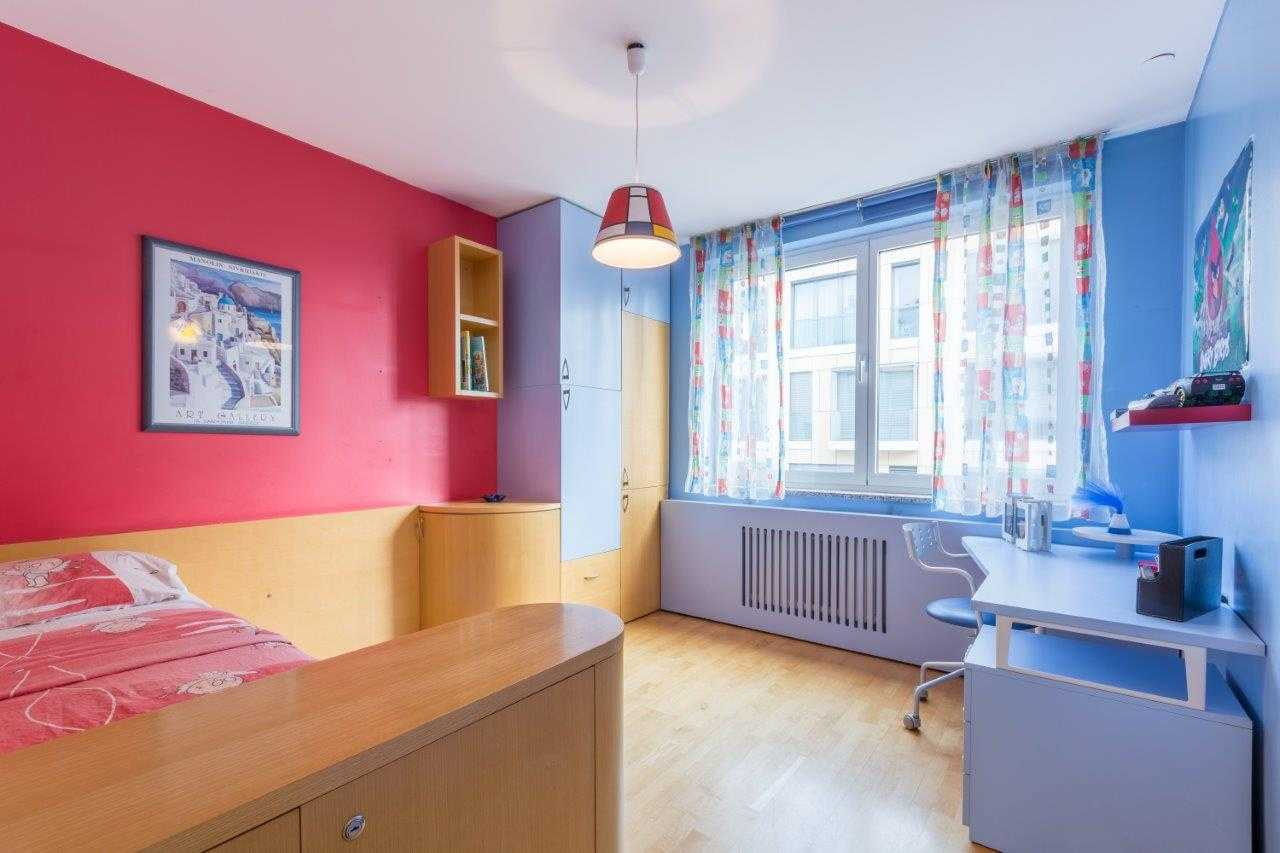 The second bedroom is bright and colourful.