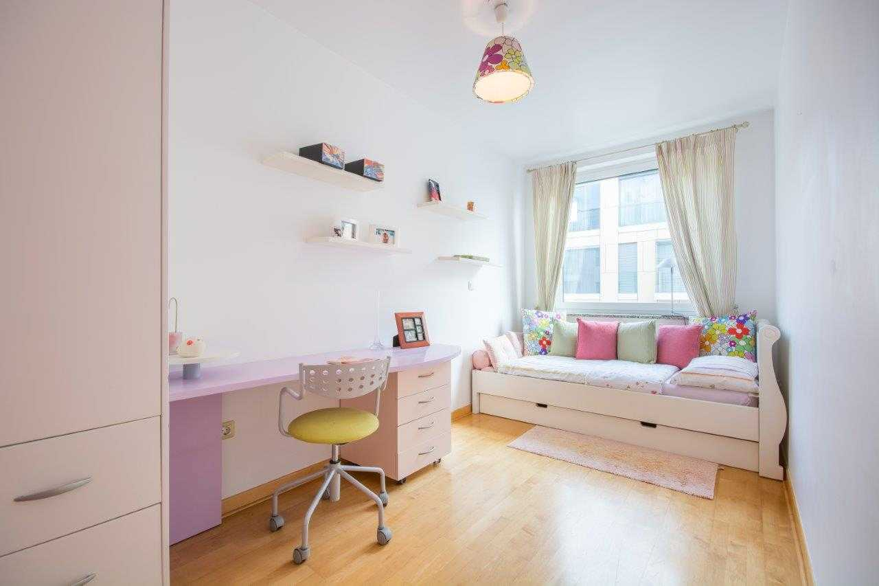 The children's bedroom has a work desk and a cozy bed.