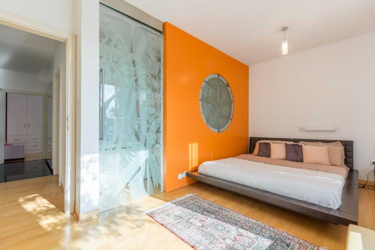 The master bedroom is lit through the large windows.
