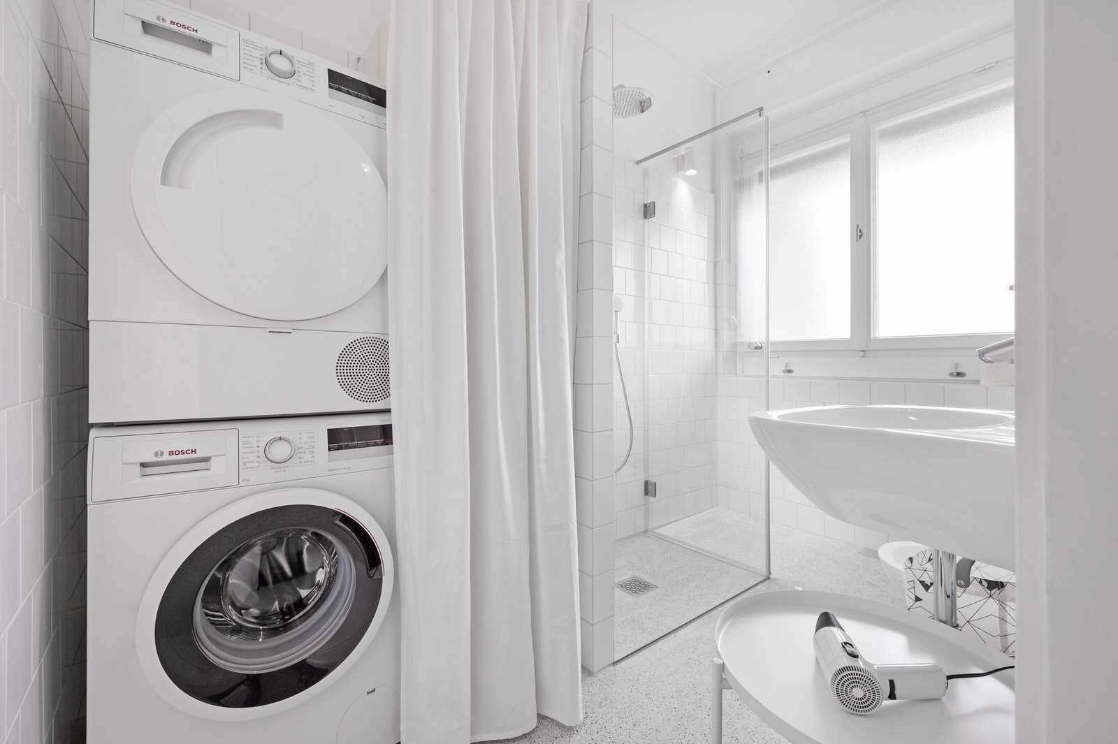 Modern bathroom with new appliances - washer and dryer