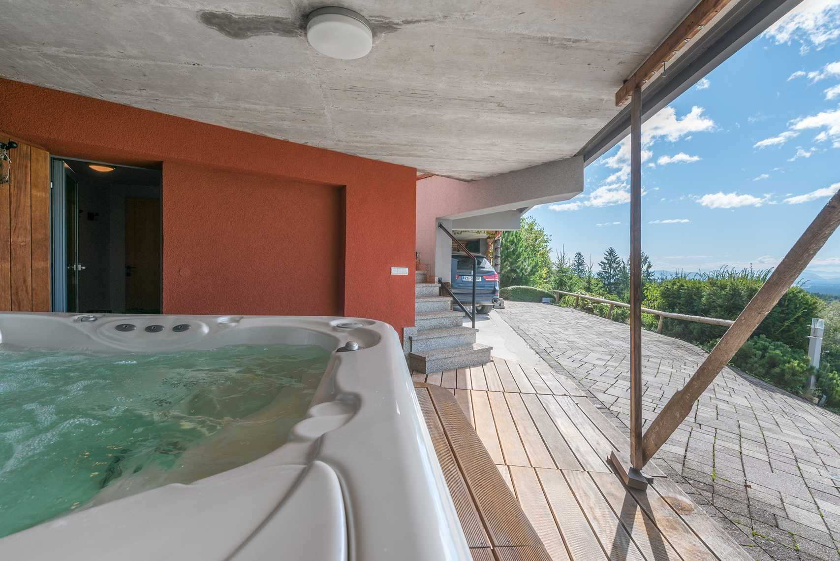 The jacuzzi is under a roof so you can enjoy it even in the summer rain.