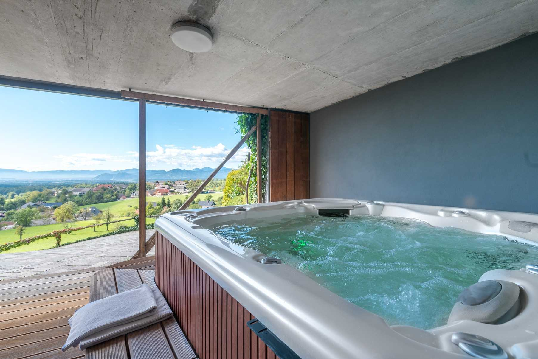The jacuzzi has a fantastic view of the countryside.