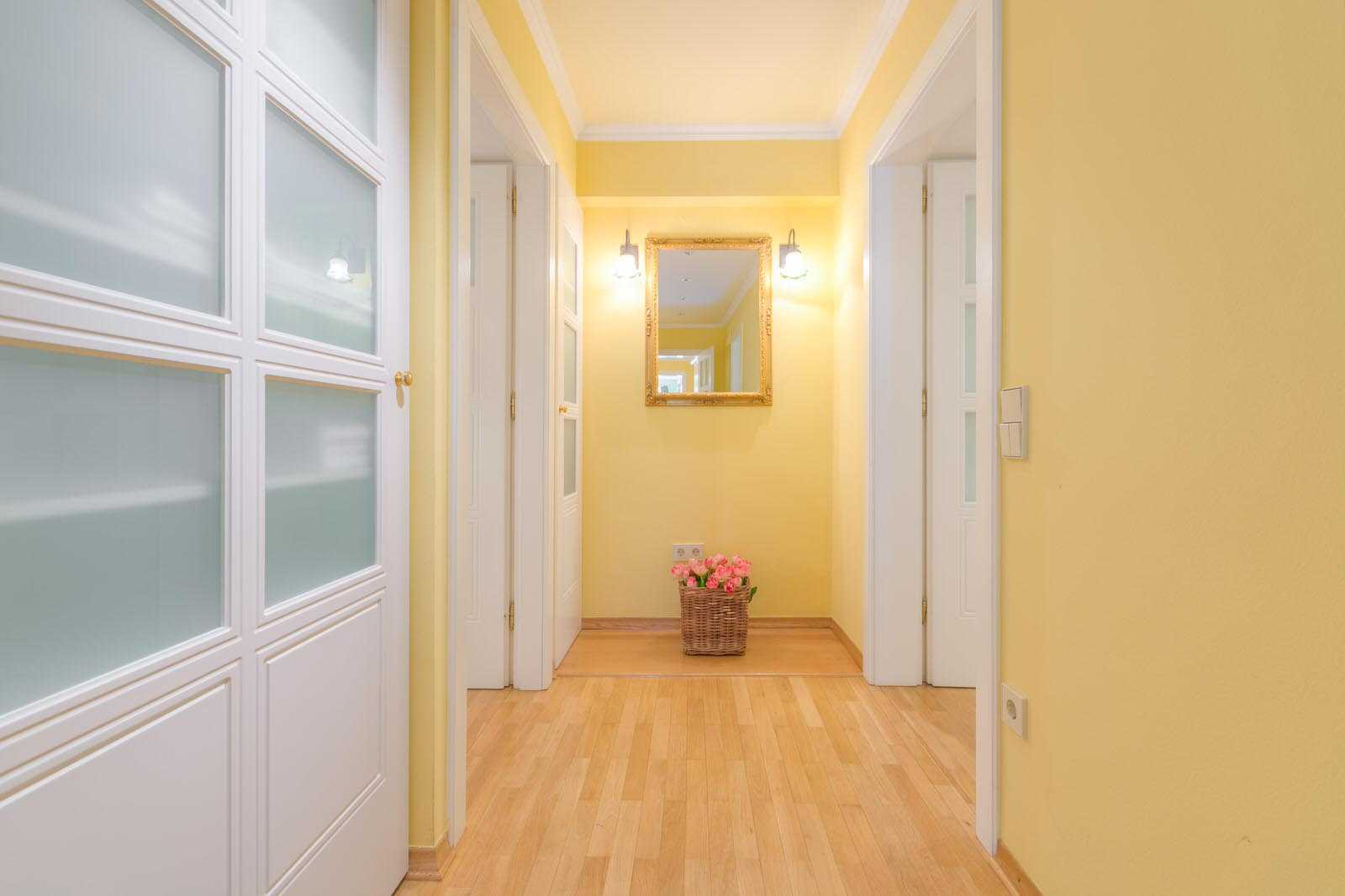 The hallways have concealed closets.