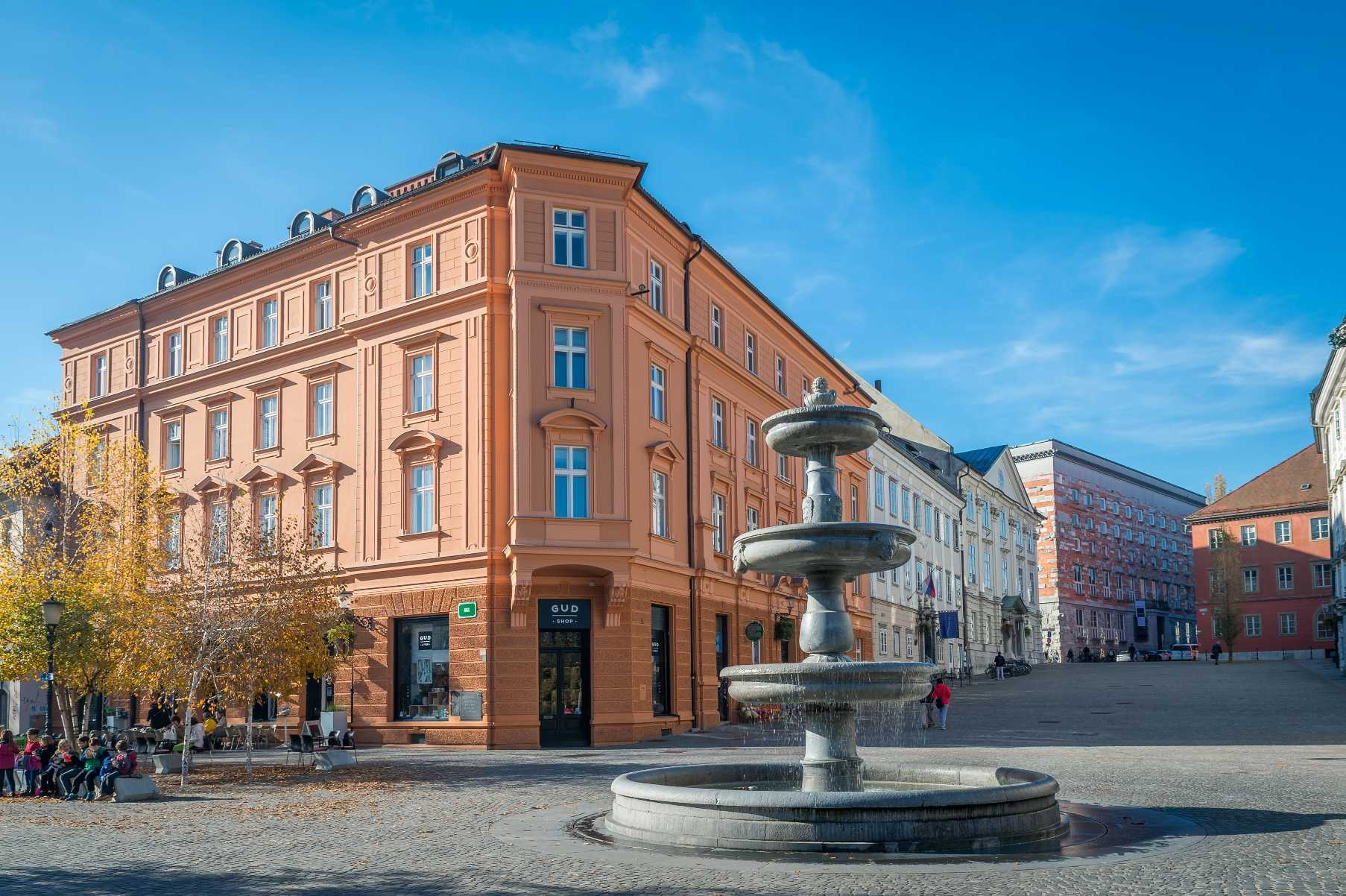 The apartment is located in a renovated orange building on Novi Trg.